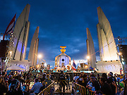 """15 NOVEMBER 2013 - BANGKOK, THAILAND:  Democracy Monument, scene of anti-government protests in Bangkok. Tens of thousands of Thais packed the area around Democracy Monument in the old part of Bangkok Friday night to protest against efforts by the ruling Pheu Thai party to pass an amnesty bill that could lead to the return of former Prime Minister Thaksin Shinawatra. Protest leader and former Deputy Prime Minister Suthep Thaugsuban announced an all-out drive to eradicate the """"Thaksin regime."""" The protest Friday was the biggest since the amnesty bill issue percolated back into the public consciousness. The anti-government protesters have vowed to continue their protests even though the Thai Senate voted down the bill, thus killing it for at least six months.    PHOTO BY JACK KURTZ"""