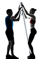 personal trainer man coach and woman exercising gymstick silhouette  studio isolated on white background