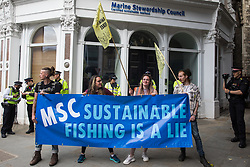 Activists from Ocean Rebellion stand outside the offices of the Marine Stewardship Council during a National Animal Rights March on 28th August 2021 in London, United Kingdom. Animal Rebellion, an offshoot of Extinction Rebellion, organised the march for the sixth day of Extinction Rebellion's protests in London, with stops at Smithfield meat market, Unilever (which owns brands that sell dairy products and use palm oil), Cargill (which is one of the world's largest meat processors) and the Marine Stewardship Council.