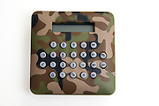 Calculator with military camouflage colours on white background