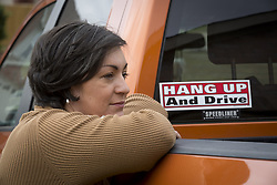 Nov. 11, 2014 - Roanoke, TX, USA - Jennifer Zamora-Jamison of Roanoke, Texas, is working to persuade Texas lawmakers to pass a statewide ban on texting and driving. Zamora-Jamison's husband was killed by a distracted driver seven years ago, and her daughter, who was with her father in the car but survived the crash, recently committed suicide. (Credit Image: © Joyce Marshall/TNS/ZUMA Wire)