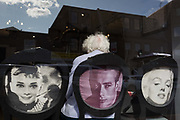 An elderly lady seated on a chair featuring Hollywood movie stars Audrey Hepburn, James Dean and Marylin Monroe, waits her turn in a local hairdressers, on 2nd October 2019, in Sutton, London, England. Voters in Sutton voted 53.7% in favour of Brexit during the 2016 referendum.