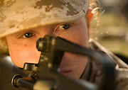Marine Corps recruit Susanna Sol looks down her weapon's sites during training at Parris Island, S.C., on Nov. 24, 2007. (Photo by Stacy L. Pearsall)