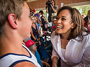03 JULY 2019 - WEST DES MOINES, IOWA: US Senator KAMALA HARRIS, right, (D-CA)  talks to a middle school student at the West Des Moines Democrats' annual 4th of July Picnic. Senator Harris attended the picnic to support her bid to be the Democratic nominee for the US presidency in 2020. Iowa hosts the first presidential selection event of the 2020 election cycle. The Iowa Caucuses are scheduled for Feb. 3, 2020.        PHOTO BY JACK KURTZ