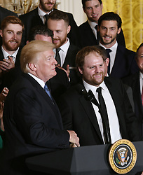 U.S. President Donald Trump checks hands with Penguins' Sidney Crosby during a ceremony to welcome the Stanley Cup Champions, The Pittsburgh Penguins to the White House Oct. 10, 2017 in Washington D.C.. Photo by Olivier Douliery/ Abaca Press