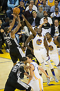 Golden State Warriors forward Draymond Green (23) attempts to block a jumper by San Antonio Spurs forward Kawhi Leonard (2) at Oracle Arena in Oakland, Calif., on October 25, 2016. (Stan Olszewski/Special to S.F. Examiner)