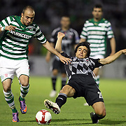 Bursaspor's Sercan YILDIRIM (L) and Besiktas's Ibrahim TORAMAN (R) during their Turkish soccer super league match Bursaspor between Besiktas at Ataturk Stadium in Bursa Turkey on Sunday, 16 May 2010. Photo by TURKPIX