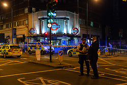 Police and paramedic vehicles at the scene where a seventeen-year-old , the second teenager in less than 24 hours, was stabbed and died outside Clapham South Underground Station. Clapham South, London, November 02 2018.