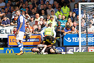 Sheffield Wednesday goalkeeper Keiren Westwood (1) is injured in a challenge and is immediately seen to by Burton Albion striker Marvin Sordell (17) during the EFL Sky Bet Championship match between Burton Albion and Sheffield Wednesday at the Pirelli Stadium, Burton upon Trent, England on 26 August 2017. Photo by Richard Holmes.