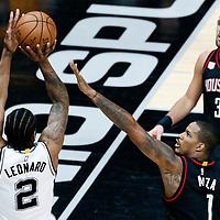 03 May 2017: San Antonio Spurs forward Kawhi Leonard (2) takes a jump shot over Houston Rockets forward Trevor Ariza (1) during the San Antonio Spurs 121-96 victory over the Houston Rockets, in game 2 of the Western Conference Semi Finals, at the AT&T Center, San Antonio, Texas, USA.