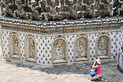 Tourist taking photograph at Wat Arun,Temple of the Dawn, Bangkok, Thailand