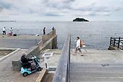 people at Umikaze park, Yokosuka with Tokyo Bay and Sarushima Island