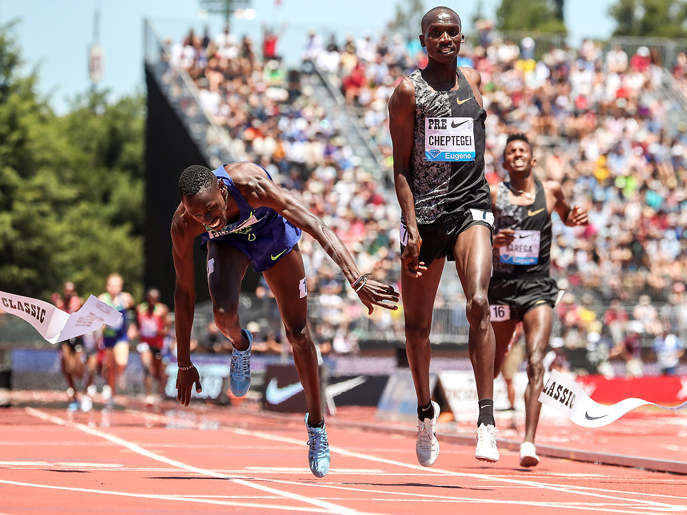 Joshua Cheptegei, Kenya, beats a diving Paul Chelimo, USA, at the finish line to win mens 2-Mile in 8:07.54 at 2019 The Prefontaine Classic Track & Field<br /> IAAF Diamond League