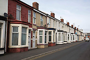 A row of terraced houses in Bloomfield ward, Blackpool, Lancashire, England, United Kingdom. Bloomfield ward is the poorest council ward in Blackpool and one of the poorest in England.