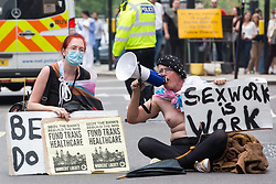 A trans rights campaigner sits in Oxford Street to address thousands of LGBTI+ protesters taking part in the first-ever Reclaim Pride march on 24th July 2021 in London, United Kingdom. Reclaim Pride replaced the traditional Pride in London march, which many feel has become too commercial and strayed from its roots in protest, and was billed as a People's Pride march for LGBTI+ liberation. Campaigners called for the banning of LGBTI+ conversion therapy, the reform of the Gender Recognition Act, the provision of a safe haven for LGBTI+ refugees and for LGBTI+ people to be decriminalised worldwide and marched in solidarity with Black Lives Matter.