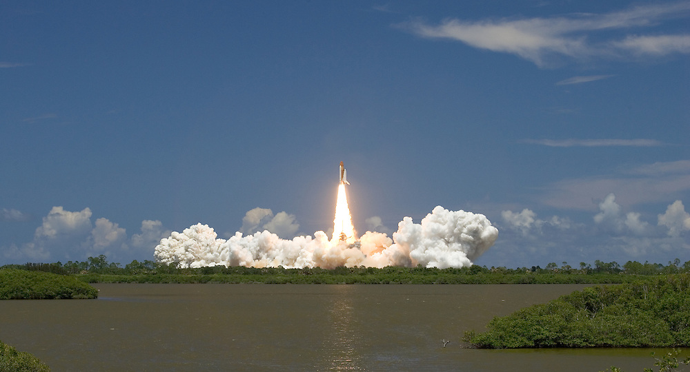 Space Shuttle Discovery launch, STS-121<br /> <br /> Discovery clears launch pad 39B at Kennedy Space Center on the way to the International Space Station on Tuesday, July 4, 2006.