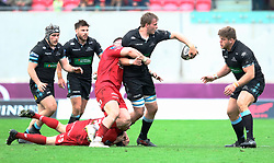 Glasgow Warriors' Jonny Gray looks to offload<br /> <br /> Photographer Simon King/Replay Images<br /> <br /> Guinness PRO14 Round 19 - Scarlets v Glasgow Warriors - Saturday 7th April 2018 - Parc Y Scarlets - Llanelli<br /> <br /> World Copyright © Replay Images . All rights reserved. info@replayimages.co.uk - http://replayimages.co.uk