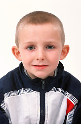 Portrait of young boy with crew cut,