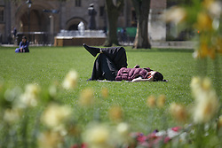 © Licensed to London News Pictures. 21/04/2015. Bristol, Avon, UK. A woman sunbathing enjoying the warm weather on College Green in Bristol today, 21st April 2015. The south west of England is set for more warm temperatures and plenty of sunshine today. Photo credit : Rob Arnold/LNP
