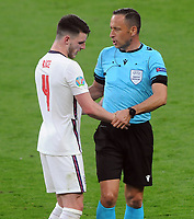 Football - 2021 UEFA European Championships - Finals - Group D - Czech Republic vs England - Wembley Stadium<br /> <br /> Referee, Arthur Dias grabs hold of England's  Declan Rice<br /> <br /> Credit : COLORSPORT/ANDREW COWIE