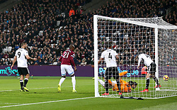 West Ham United's Javier Hernandez (second bottom right) scores his side's first goal of the game during the Premier League match at London Stadium.