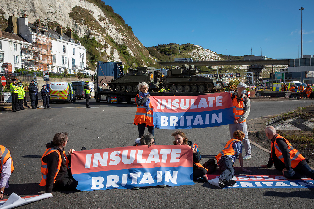 Activist from Insulate Britain blockade the entrance to the port of Dover on the 24th of September 2021. Over 40 activists from Insulate Britain blocked the road with some gluing themselves to the carriageway of the A20 at the Eastern docks roundabout. There are blocking the roads to highlight that fuel poverty is killing people in Dover and across the UK. (photo by Andrew Aitchison / In pictures via Getty Images)