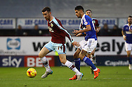 David Jones of Burnley (l) looks to get away from Kevin Bru of Ipswich Town Skybet football league Championship match, Burnley v Ipswich Town at Turf Moor in Burnley, Lancs on Saturday 2nd January 2016.<br /> pic by Chris Stading, Andrew Orchard sports photography.