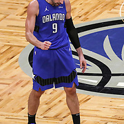 ORLANDO, FL - FEBRUARY 19:  Nikola Vucevic #9 of the Orlando Magic celebrates after defeating the Golden State Warriors during the second half at Amway Center on February 19, 2021 in Orlando, Florida. NOTE TO USER: User expressly acknowledges and agrees that, by downloading and or using this photograph, User is consenting to the terms and conditions of the Getty Images License Agreement. (Photo by Alex Menendez/Getty Images)*** Local Caption ***  Nikola Vucevic