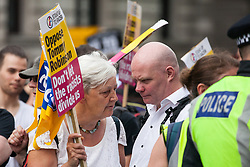 London, UK. 9th June, 2018. Candy Udwin of PCS and Steve Hedley, Senior Assistant General Secretary of the RMT, take part in an anti-fascist protest against the March for Tommy Robinson outside Downing Street.