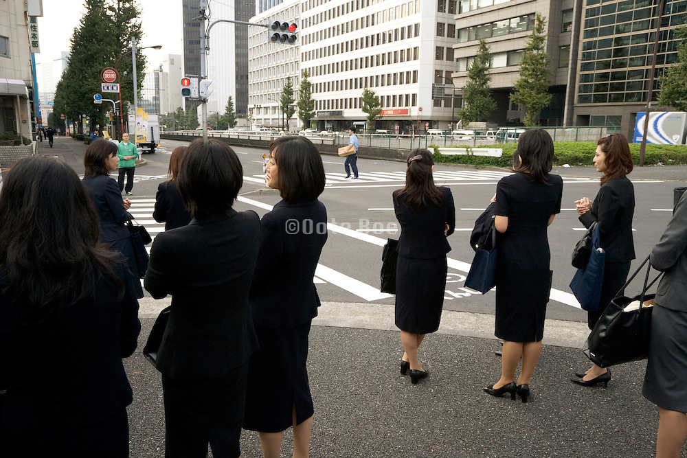 group of businesswoman waiting at a traffic light Tokyo Japan