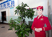 A cardboard airline attendant stands at attention in a bus station in Linhe, in Inner Mongolia. Tourism in China has greatly expanded over the last few decades since the beginning of reform and opening. The emergence of a newly rich middle class and an easing of restrictions on movement by the Chinese authorities are both fueling this travel boom. China is the world's third most visited country in the world. The number of overseas tourists was 55.98 million in 2010.