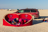 Love's Hug<br /> by: Anna Mok<br /> from: Palo Alto & San Francisco, CA<br /> year: 2019<br /> <br /> Love's Hug rises from the desert as a protected space where one can be extrospective and introspective. It will invoke individual and collective reflections and thoughtful dialogue of the love, happiness and joy that humans create for ourselves and each other.<br /> <br /> Love's Hug invites us to take a rest from the chaos, share an embrace, cuddle with others and be engulfed by human love and warmth in this safe place where we can (re)connect with our own hearts and those of others around us. These connections allow us to remember the limitless powers of the human heart and is a catalyst for transformations.<br /> <br /> URL: https://www.facebook.com/groups/306358213575925/<br /> <br /> https://burningman.org/event/brc/2019-art-installations/?yyyy=&artType=h#a2I0V000001AX9kUAG My Burning Man 2019 Photos:<br />