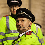 A senior Met police officer surveying the square from the steps. The London Stock Exchange was attempted occypied in solidarity with Occupy Wall in Street in New York and in protest againts the economic climate, blamed by many on the banks. Police managed to keep people away fro the Patornoster Sqaure and the Stcok Exchange and thousands of protestors stayid in St. Paul's Square, outside St Paul's Cathedral. Many camped getting ready to spend the night in the square.