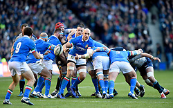 Italy's Sergio Parisse offloads the ball during the Guinness Six Nations match at BT Murrayfield Stadium, Edinburgh.