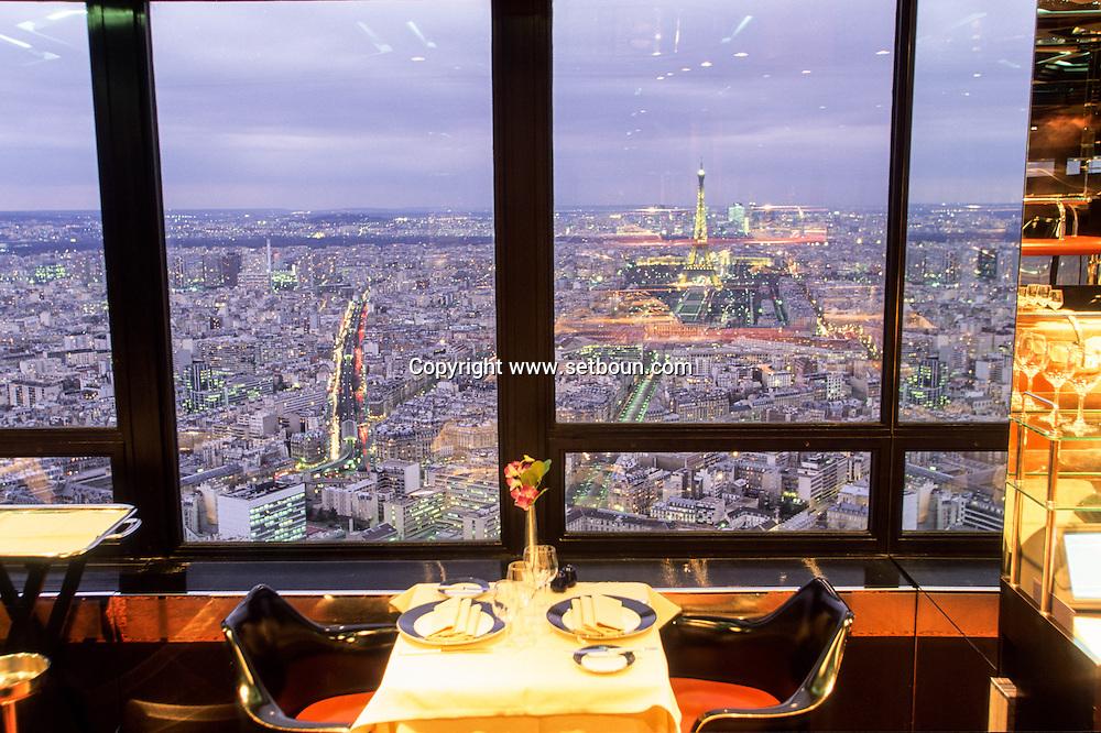 """France Paris. Panoramic view on the Eiffel tower and paris. View from """"Sous le ciel de Paris """"Montparnasse tower restaurant  and bar"""