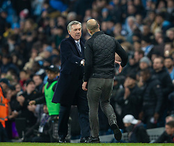 MANCHESTER, ENGLAND - Wednesday, January 1, 2020: Everton's manager Carlo Ancelotti (L) and Manchester City's manager Pep Guardiola shake hands at the final whistle during the FA Premier League match between Manchester City FC and Everton FC at the City of Manchester Stadium. Manchester City won 2-1. (Pic by David Rawcliffe/Propaganda)
