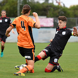 BRISBANE, AUSTRALIA - DECEMBER 10: Joshua Mori of Adelaide United is tackled by Aaron Reardon of the Roar during the round 5 Foxtel National Youth League match between the Brisbane Roar and Adelaide United at AJ Kelly Field on December 10, 2016 in Brisbane, Australia. (Photo by Patrick Kearney/Brisbane Roar)