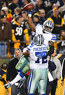 PITTSBURGH, PA - NOVEMBER 13:  Ezekiel Elliott #21 is hugged by Travis Frederick #72 of the Dallas Cowboys after rushing for a 32 yard touchdown in the fourth quarter during the game against the Pittsburgh Steelers at Heinz Field on November 13, 2016 in Pittsburgh, Pennsylvania. (Photo by Joe Sargent/Getty Images) *** Local Caption *** Ezekiel Elliott; Travis Frederick