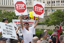 June 16, 2017 - Detroit, Michigan, U.S. - Detroit, Michigan USA - 16 June 2017 - Members of Detroit's Chaldean community of Iraqi Christians protest the government's arrest of dozens of Iraqis who they plan to deport. Family members say that Iraqi Christians face genocide if they are returned to Iraq. (Credit Image: © Jim West via ZUMA Wire)