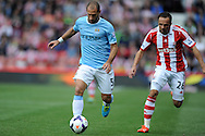 Manchester City's Pablo Zabeleta breaks away from  Stoke's Matthew Etherington during the Barclays Premier league match, Stoke city v Manchester city at the Britannia Stadium in Stoke on Trent on Sat 14th Sept 2013. pic by Jeff Thomas, Andrew Orchard sports photography,