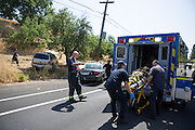 Jeffrey Prachick, 17, of Milpitas, is wheeled into an ambulance after crashing his Dodge Durango SUV during an alleged speed contest with another car near Jacklin Road and Evans Road in Milpitas, California, on June 6, 2013. (Stan Olszewski/SOSKIphoto)