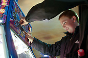 A boy plays in an amusement arcade at Alton Towers