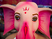 10 SETEMBER 2018 - BANGKOK, THAILAND:  A face of the Hindu deity Ganesha at Wat Witsanu Hindu Temple (also called the Vishnu Temple) in Bangkok. Indian craftsmen are making statues of the Hindu deity Ganesha for the Ganesh Chaturthi, or Ganesh Festival, held at Hindu temples in September. All of the craftsmen, and the clay they use to fashion the statues, come from India every year to make the statues. Although Thais are predominantly Buddhist, the Lord Ganesh, the Hindu overcomer of obstacles, is worshipped by many Thais and Ganesh Chaturthi is celebrated in many Thai communities.       PHOTO BY JACK KURTZ