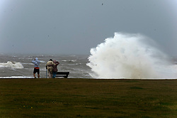 © Licensed to London News Pictures. 25/08/2020. Porthcawl, Bridgend, Wales, UK. Storm Francis batters the small Welsh seaside resort of Porthcawl in Bridgend, UK. with severe gale force winds and massive waves. Photo credit: Graham M. Lawrence/LNP