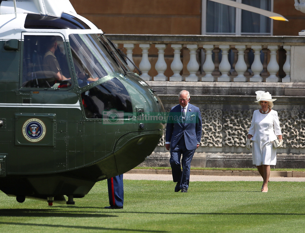 The Prince of Wales and the Duchess of Cornwall wait to meet US President Donald Trump and his wife Melania as they arrive in Marine One at Buckingham Palace, in London on day one of his three day state visit to the UK.
