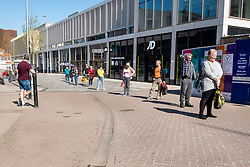 Cheapside Barnsley Town Centre and people maintain social distancing while waiting to enter the Alhambra Shopping centre, half way through the UK's third week of emergency measures which were announced Monday the 23rd April <br /> <br /> At a regular intervals a public address system remind people they should stay at home - only leave the house for very limited purposes:<br /> shopping for basic necessities, and medicine. <br /> One form of exercise a day.<br /> Any medical need.<br /> Travelling for work purposes, but only where you cannot work from home.<br /> Time spent outside should be minimised<br /> and people should keep a safe distance of 2 meters apart from anyone outside of your household.<br /> <br /> 08 April 2020<br /> <br /> www.pauldaviddrabble.co.uk<br /> All Images Copyright Paul David Drabble - <br /> All rights Reserved - <br /> Moral Rights Asserted -