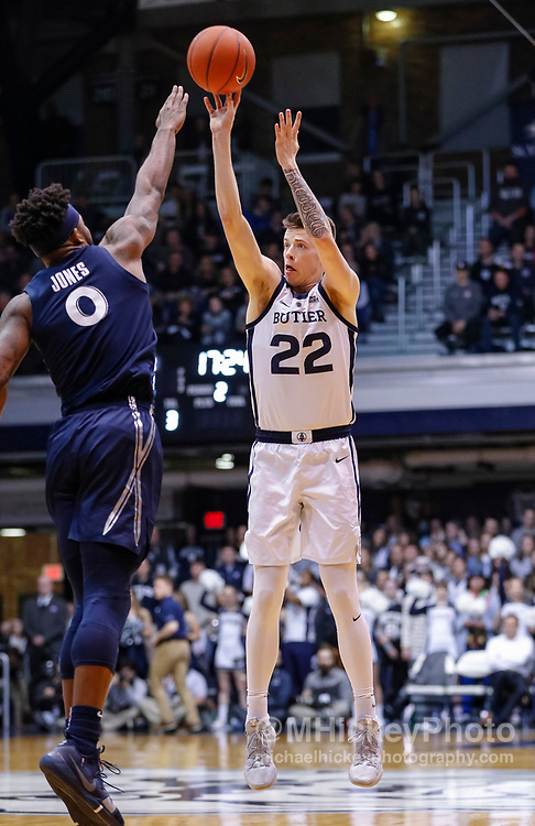 INDIANAPOLIS, IN - MARCH 05: Sean McDermott #22 of the Butler Bulldogs shoots the ball during the game against Tyrique Jones #0 of the Xavier Musketeers at Hinkle Fieldhouse on March 5, 2019 in Indianapolis, Indiana. (Photo by Michael Hickey/Getty Images) *** Local Caption *** Sean McDermott; Tyrique Jones