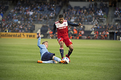 April 29, 2018 - Bronx, New York, United States - New York City midfielder ALEXANDER RING (8) slides into to steal the ball from FC Dallas midfielder SANTIAGO MOSQUERA (11) during a regular season match at Yankee Stadium in Bronx, NY.  NYCFC defeats FC Dallas 3 to 1. (Credit Image: © Mark Smith via ZUMA Wire)