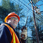 Electric utility worker fixing power lines.