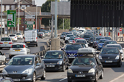 © Licensed to London News Pictures. 29/08/2016. LONDON, UK.  London bound traffic queuing at the Blackwall tunnel in south east London, as people return from the August bank holiday weekend and day trips during the sunny weather today.  Photo credit: Vickie Flores/LNP